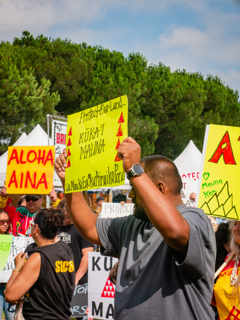 tmt protest sign reads: protect our our land, ku kia'i mauna